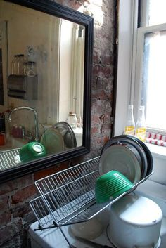 This is a kitchen on Cherokee Street in South Saint Louis. I like the lighting, the depth of the windowsill, the brick and the placement of the mirror, which I don't normally associate with kitchens.