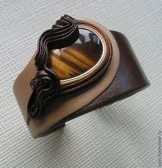 Купить или заказать Браслет из кожи 'Каприз' в интернет-магазине на Ярмарке Мастеров. Браслет из кожи с натуральным камнем тигровый глаз, гематит.. 'Каприз' Стильное украшение в гардеробе женщины, которое делает её неповторимой, индивидуальной.отличной от других. Браслет можно сделать с разным камнем и в разной цветовой гамме. К браслету могу сделать серьги и кулон.(при наличии камней). Металлическая магнитная застёжка, жёсткий каркас. Авторская ручная работа.