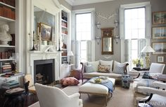 This antiques-filled Georgia living room features a French daybed, trumeau mirror, Chinese porcelain birds, and a Louis XV side chair.   - HouseBeautiful.com