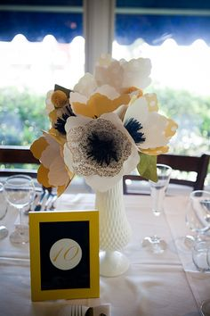 Paper flowers! www.stylemepretty.com/florida-weddings