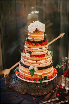 rustic naked wedding cake with fruit / http://www.deerpearlflowers.com/perfect-rustic-wedding-ideas/