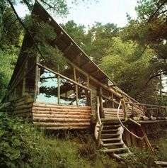 This cabin looks like it is literally immerging from the ground.... very cool.