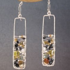 Long drop earrings with black spinel, citrine, and ivory pearls. Available in sterling silver or 14K gf
