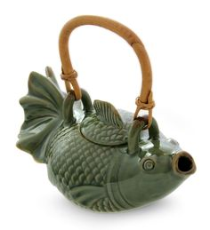 Features:  -Material - ceramic, rattan handle.  -Microwave safe.  -Dishwasher: Use top rack only. Hand wash recommended..  -Free of lead and toxins.  --Swimming sinuously through a lotus pond, a koi r