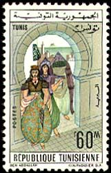 Subject  Regional Costumes: Tunis  Number  785  Size  22,5x37,5 mm  Issue Date  01/06/1963  Number issued  500000  Serie  ordinary  Printing process  Helio-engraving  Value  60 millimes  Drawing  Jalel BEN ABDALLAH