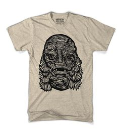 A hand carved Creature from the Black Lagoon. This creature is straight from the vintage horror movie. This actually used to scare people!  This one was carved by Joseph.  We printed this wood block with Drive by Black ink onto a super soft slightly Heather  t-shirt. Color: Slightly HeatherMaterial: 4.3 oz, - 40/60 poly/cotton Fit: True to SizeRibbed neckGraphic Wood-Block print