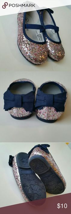 Baby Glitter Mary Jane Shoes These little shoes are so darling! They are covered with pink and silver sparkles with navy trim and bows on the back, elastic strap to keep in place. Excellent condition. Cherokee Shoes Dress Shoes