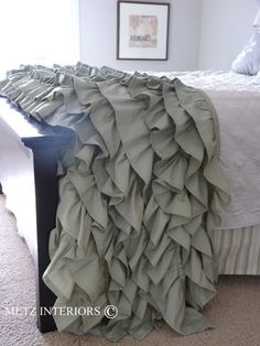 Ruffled half bedspread. I think I like this idea. It gives you the elegance without having to wash it all the time. :)