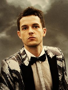 Brandon Flowers in a sequinned zebra-print jacket. Yes :)