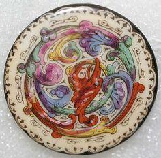 Hand-painted porcelain button.
