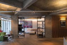 Apartment by Inside Out Architecture features chunky concrete beams