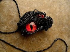 Custom - Black Wire Wrapped - Fire Dragon Eye by LadyPirotessa on DeviantArt Eye Jewelry, Jewelry Crafts, Jewelery, Jewelry Accessories, Unique Jewelry, Dragon Eye, Fire Dragon, Fantasy Jewelry, Gothic Jewelry