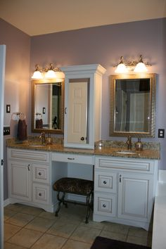 The White Cabinets With Ginger Highlights Accent Colors In Granite A Center Tower Was Requested Over Makeup Area