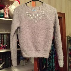 L'amour sweater from JCPenney Very comfortable cute grey sweater with a silver tear drop rhinestone floral design. Worn only twice and in great condition. jcpenney Tops Tees - Long Sleeve