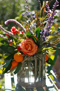 for simple rustic wedding...parts of this...love the addition of fresh tangerines...rose is tuscan sun.
