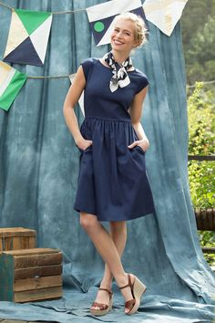 Raglan short sleeve fit and flare knee length dress with pockets.