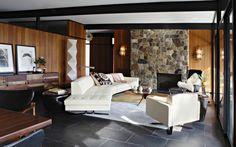 Salle de séjour moderne avec des pierres de parement intérieur