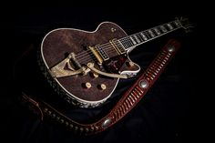 From Gretsch, has a leather top, snake skin around the sides, shotgun shell knobs, quite possibly the most beautiful guitar I've ever seen
