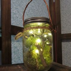 DIY Kids and Fairies ~Made from reclaimed pint size mason jar filled with twigs, moss and mini battery operated fairy lights. Fairy Lights In A Jar, Jar Lights, String Lights, Mason Jar Lanterns, Mason Jar Lamp, Jar Candles, Firefly Mason Jars, Battery Operated Led Lights, Pots