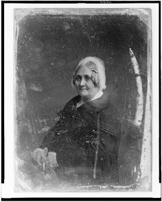 [Unidentified woman, half-length portrait, three-quarters to the left, wearing white lace cap, with hands together]