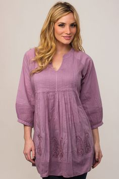 Our Saroja Lavender Tunic showcases the fine hand embroidery done by women artisans in Northern India on soft 100% cotton fabric.