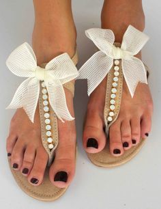 Leather Sandals with bows. I love these! I had just been looking at wedding flats, and a friend pinned these.
