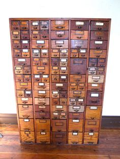 how cool is this!!!!!! i want something like this when i have my own little studio one day :)  Card Catalog/Hardware Store Cabinet
