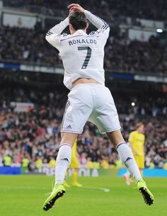 Cristiano Ronaldo of Real Madrid celebrates after scoring his teams opening goal during the La Liga match between Real Madrid and Villarreal at Estadio Santiago Bernabeu on March 2015 in Madrid, Spain. Christano Ronaldo, Cristiano Ronaldo Juventus, Cristiano Ronaldo Celebration, Villarreal Cf, Ronaldo Football, Ronaldo Real Madrid, Soccer Socks, Good Soccer Players, Lionel Messi