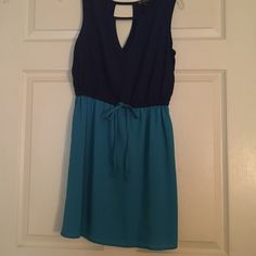 Cute blue dress! Great condition. It opens up in front and back (as seen in photos). Blue bow ties in the front. Navy blue top/lighter blue at bottom BeBop Dresses Mini