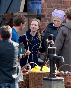 Getting into character: Mia Wasikowska slips into a naval jacket as she films scenes for  Through The Looking Glass