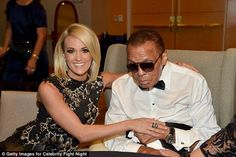 This is believed to be a photo from Ali's last public appearance at Celebrity Fight Night XXII at the JW Marriott resort in Phoenix. He is pictured alongside singer Carrie Underwood