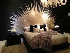 Sunburst headboard at Christopher Guy--gold painted dowel rods, and plenty of them.