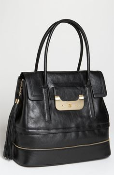 Diane Von Furstenberg... I can feel the softness & the smell of this leather...the perfect black leather handbag... ♡