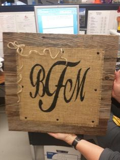 Rustic wood and burlap sign.