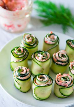 smoked salmon cucmber rolls (replace cream cheese w cottage cheese ? easy smoked salmon cucmber rolls - maybe adding a little horseradish? The best smoked salmon cucumber appetizers. Thinly sliced cucumber rolled up with smoked salmon cream cheese spread Cucumber Appetizers, Yummy Appetizers, Appetizer Recipes, Seafood Recipes, Party Appetizers, Cucumber Recipes, Vegtable Appetizers, Seafood Dip, Canapes Recipes