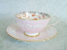 oh my!!! how i would love to own one of these!!!! Vintage Pink Paragon Fortune Telling Teacup