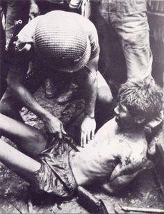 Vietnamese soldier being tortured by American troop