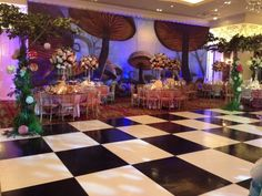 Alice in Wonderland Theme Bat Mitzvah Centerpieces & Backdrop Decorations  Lots of good ideas, ESP. Painted backdrop and chessboard dance floor.