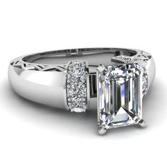 I love step cut stones. So clear, like ice. Emerald cut diamond Engagement Ring 1.76ct 18kt by blueriver47, $5880.00