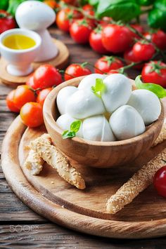 Italian mozzarella with tomato and basil by OxanaDenezhkina