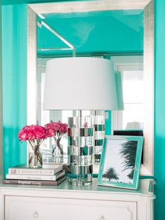 A table lamp sits on a white nightstand in front of a mirror in the master suite bedroom of HGTV Dream Home 2016 on Merritt Island, FL.