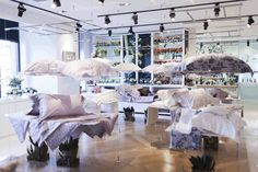 'Floating' pillows & bedsheets at Haus 658 flagship in Shanghai, designed by Malherbe Design #VM