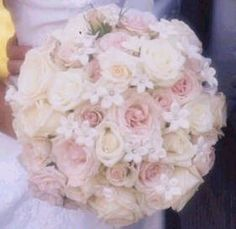 Pale roses with pearled stephanotis bouquet