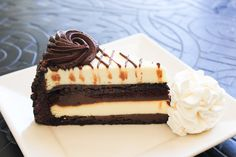 Layers of Our Original Cheesecake, Fudge Cake and Chocolate Truffle Cream.- 30th Anniversary Chocolate Cake Cheesecake