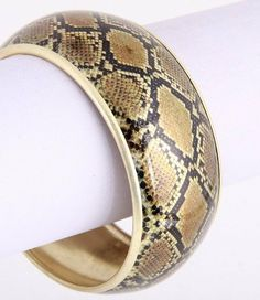 "Metal Bangle/ Inside Diameter: 2.5"" / 1.25"" H / Snake Skin Print on Gold Colored Metal Glitzs. $12.75"