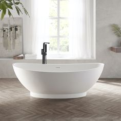 The Annecy freestanding bath has clean, soft lines and a sculptural quality that make it a beautiful centrepiece to any bathroom. Made in luxurious solid surface material, it has a smooth texture and excellent heat-retention properties, is easy to maintain and stain resistant. Available now in 180cm. #solidsurface #bathroomdecor #modernbathrooms #freestandingbath Oak Vanity Unit, Freestanding Vanity Unit, Modern Bathtub, Modern Bathroom, Corian Colors, Round Building, Solid Surface, Bathroom Furniture, Decor Styles