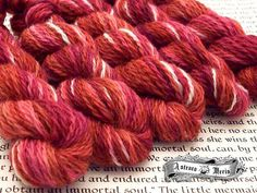 """""""Heart"""" is a space dyed yarn in a deep rich red hints of dark pumpkin highlights of pink and with shots of cream.  #yarn #knitting #knittersofinstagram #crochet #crochetersofinstagram #amigurumi #miniskeins #sockyarn #indiedyer #etsy #ravelry by astraeameris"""