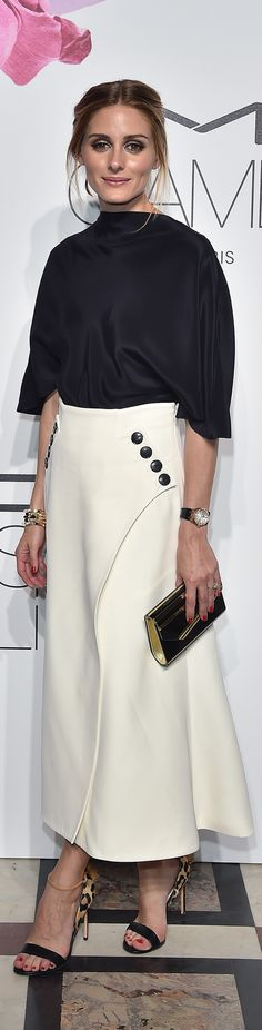 Olivia Palermo styled her favorite Francesco Russo leopard print calf hair sandals on the red carpet with a full white button front skirt, satin blouse, and gold accessories.