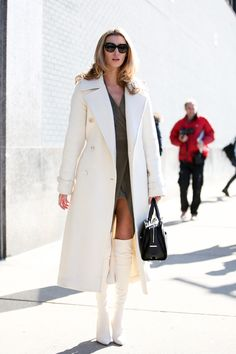 Below-Freezing NYC Street Style That's Still Fire #refinery29  http://www.refinery29.com/2015/02/82279/new-york-fashion-week-2015-street-style-pictures#slide-7  Short skirt and a looooooong jacket.