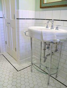 subway wall tile + vintage styled hexagon floor tile + 1920's inspired sink.